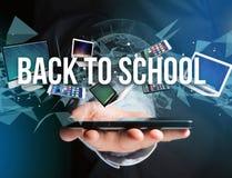 De volta ao título da escola cercado pelo dispositivo goste do smartphone, tabuleta Fotos de Stock Royalty Free