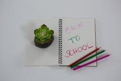 De volta ao texto de escola escrito no livro espiral Fotos de Stock Royalty Free