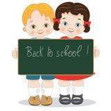 De volta a uma escola de duas crianças de sorriso com quadro-negro Imagem de Stock