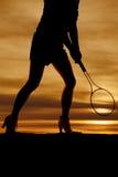 De voorzijde van het de benentennis van de silhouetvrouw stock foto