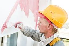 De voorzijdeschilder van de bouwer op het werk stock afbeelding