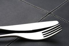 De vork en het mes van het metaal met abstract licht Royalty-vrije Stock Foto