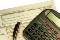 De vorm en de calculator van de belasting Royalty-vrije Stock Afbeeldingen