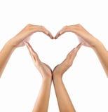 De vorm van de liefde door handen Stock Foto's