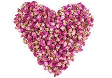 De vorm van een hart maakte uit droge rozen Stock Afbeelding