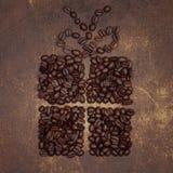 De vorm van een heden met een boog op bovenkant maakte uit een koffiebonen Royalty-vrije Stock Afbeelding