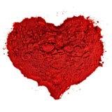 De Vorm van het hart die uit fijn rood zand wordt gemaakt. royalty-vrije stock afbeelding