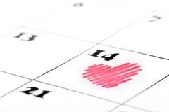 De vorm van het hart op de kalender van de valentijnskaartdag Stock Foto