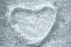 De vorm van het hart op sneeuw Stock Afbeelding