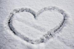 De vorm van het hart in sneeuw Royalty-vrije Stock Foto