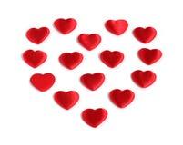 De vorm van het hart van vele kleine rode harten Stock Afbeeldingen