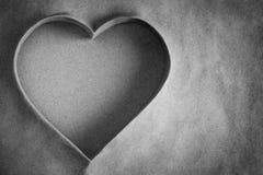 De vorm van het hart in zand Stock Foto