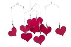 De vormen van het hart het hangen Stock Afbeeldingen