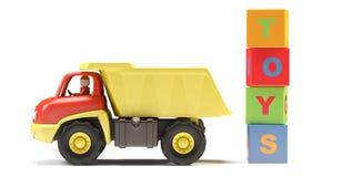 De vrachtwagen en de kubussen van het stuk speelgoed Royalty-vrije Stock Fotografie