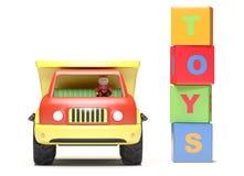 De vrachtwagen en de kubussen van het stuk speelgoed Stock Afbeelding