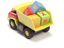 De vrachtwagen en de kubussen van het stuk speelgoed Stock Foto