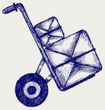 De vrachtwagen van de hand met postpakketten Stock Afbeeldingen