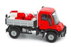 De vrachtwagen van het stuk speelgoed met pillen Royalty-vrije Stock Afbeeldingen