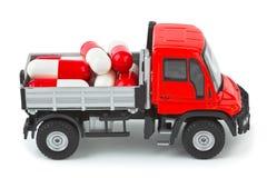 De vrachtwagen van het stuk speelgoed met pillen Stock Fotografie