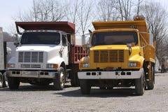 De Vrachtwagens van de stortplaats stock foto's