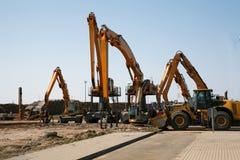 De vrachtwagens van het hout en andere machines stock foto