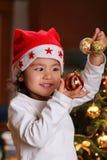 De vreugdeuitdrukking van Kerstmis op kindgezicht Royalty-vrije Stock Afbeelding