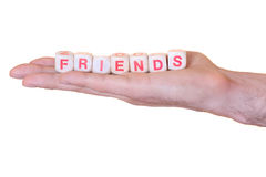 De vrienden met houten worden dobbelen op een hand, op witte achtergrond wordt geïsoleerd geschreven die Royalty-vrije Stock Afbeeldingen