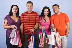 De vrienden van mensen met het winkelen zakken Royalty-vrije Stock Foto's