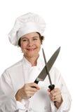 De vriendschappelijke Chef-kok scherpt Mes Royalty-vrije Stock Fotografie