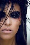 De vrij donkerbruine vrouw met maakt omhoog als demon bij Stock Foto's