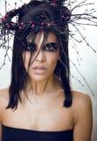 De vrij donkerbruine vrouw met maakt omhoog als demon bij Royalty-vrije Stock Foto's