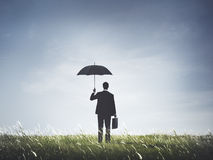 De Vrijheidsconcept van zakenmanumbrella protection risk Stock Foto's
