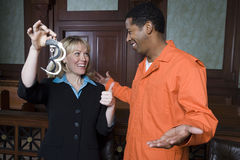 De Vrijspraak van advocaatand client celebrating Stock Fotografie