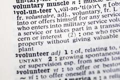 De vrijwilligersdienst helpt anderen woordenboek stock foto