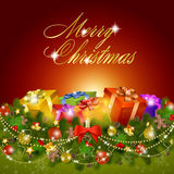 De vrolijke kaart van de Kerstmisgroet met giftdozen Stock Afbeeldingen
