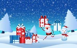 De vrolijke Kerstman, de giftdoos van de sneeuwmanholding Kerstmis stelt in sneeuwscène voor Vrolijke Kerstmis en Gelukkig Nieuwj Stock Foto