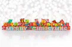 De vrolijke Kerstmis zilveren tekst op de achtergrond van varicolored GIF royalty-vrije stock foto