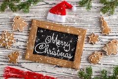 De vrolijke prentbriefkaar van Kerstmisgroeten met peperkoekkoekje royalty-vrije stock fotografie
