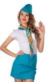 De vrolijke stewardess heeft een hand, het welkom heten opgeheven Stock Fotografie
