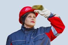 De vrouw in beschermende werkkledij arbeidsbescherming royalty-vrije stock afbeeldingen