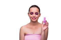 De vrouw die die lippenstift toepassen op wit wordt geïsoleerd royalty-vrije stock foto's