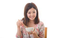 De vrouw die eet Stock Fotografie