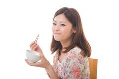 De vrouw die eet Royalty-vrije Stock Afbeeldingen