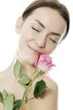 De vrouw die roze houdt nam toe Stock Fotografie