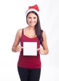 De vrouw die van de kerstman leeg teken toont Stock Afbeelding