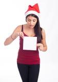 De vrouw die van de kerstman leeg teken toont Royalty-vrije Stock Foto's