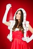 De vrouw die van de kerstman magische Kerstmisklok houdt stock fotografie