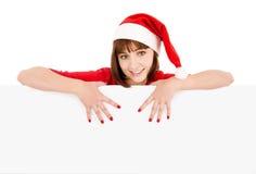 De vrouw die van de kerstman op leeg tekenaanplakbord richt Royalty-vrije Stock Foto's