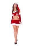 De vrouw die van de kerstman vooruit loopt Stock Foto