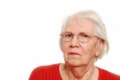 De vrouw die van Eldery glazen draagt Stock Afbeeldingen